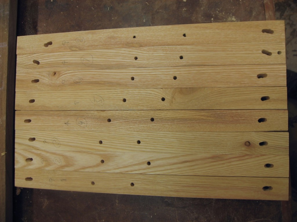 I elongate the holes at the outer edges to allow for wood movement.