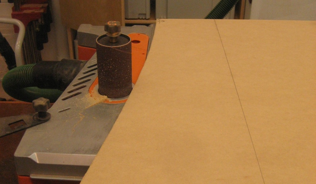 A spindle sander cleans up the edge