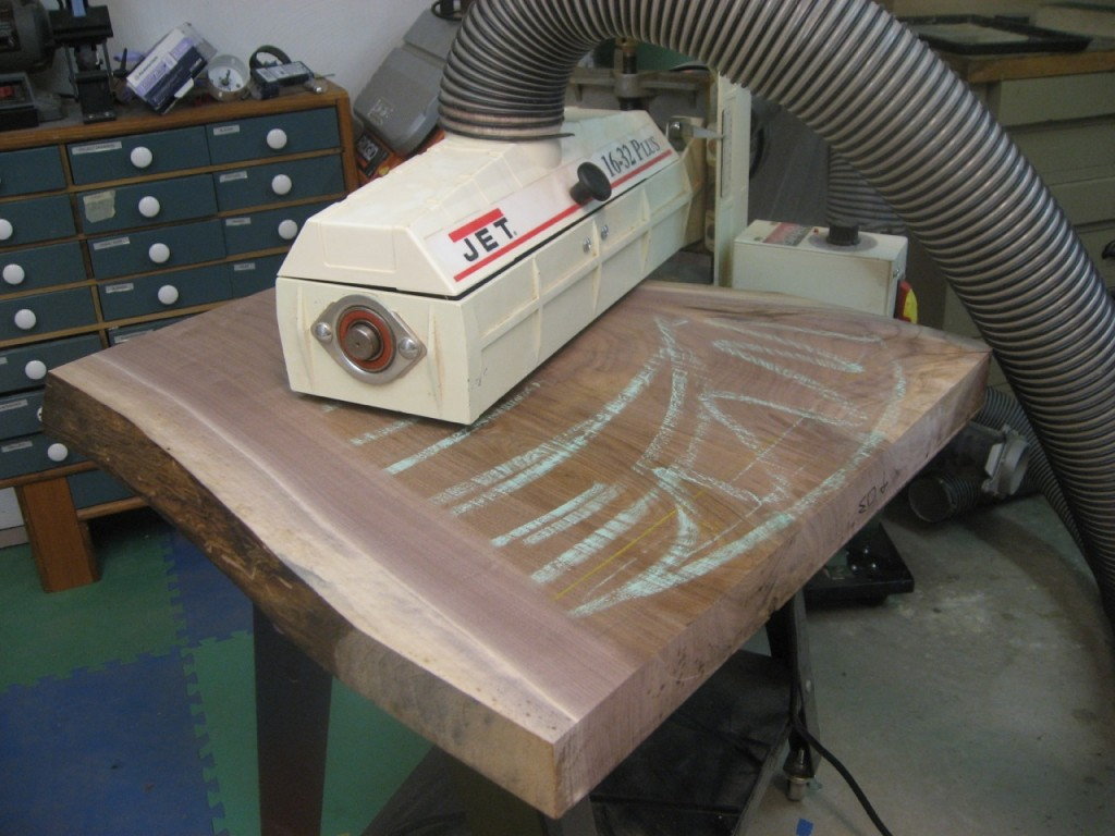 An open-ended Jet drum sander is used to flatten the other side