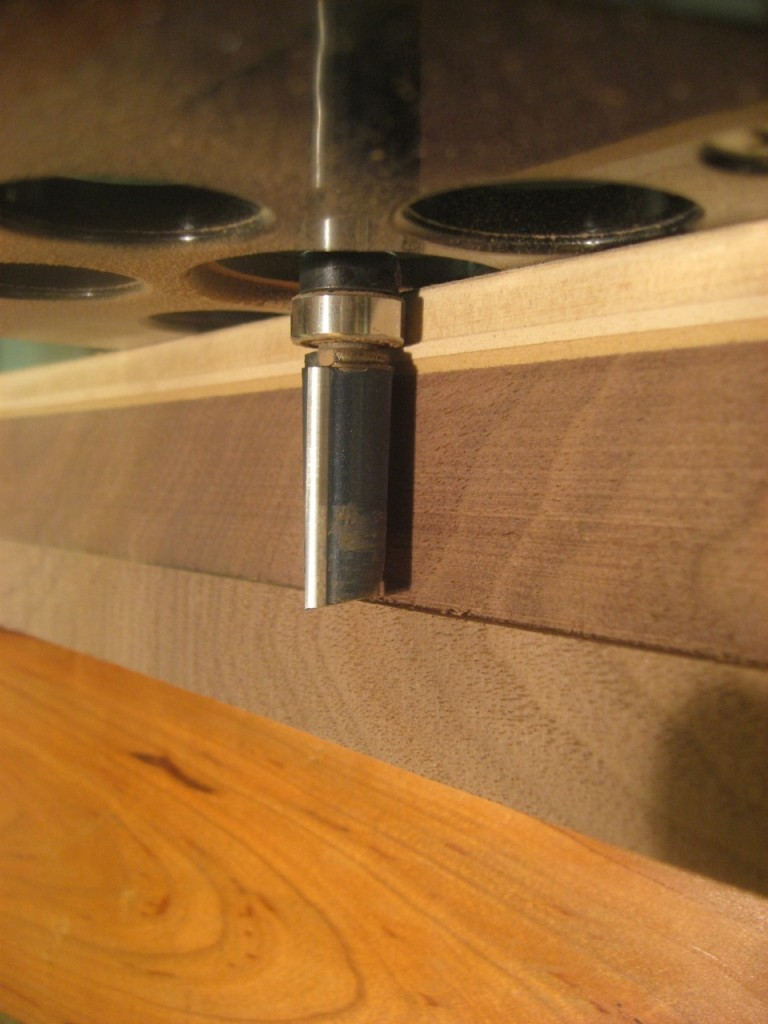 A pattern router bit rides on the template to flush up the workpiece.