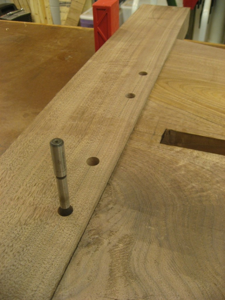 I use the same forstner bit to mark the hole location in the tenon.