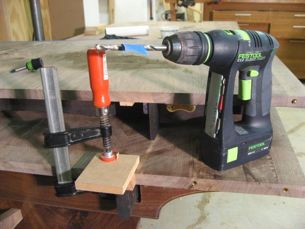 Tools for the alignment pins: drill, jig and clamp.