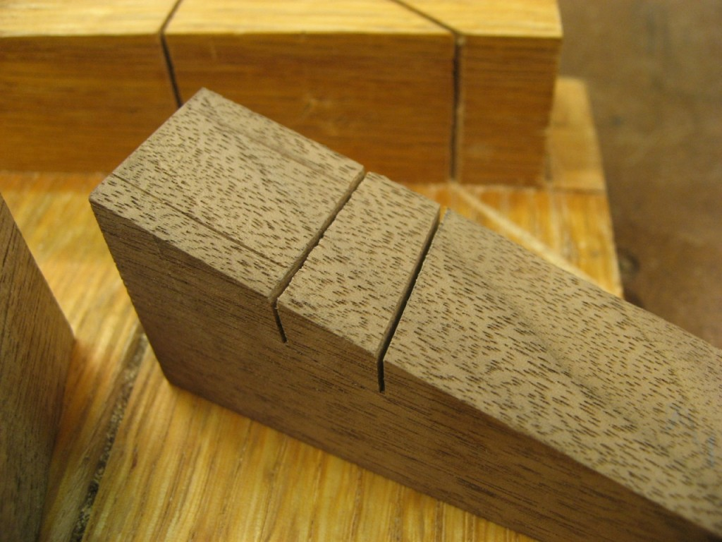 Sawing down my dovetail pin to clearly define two sides of an angled dado