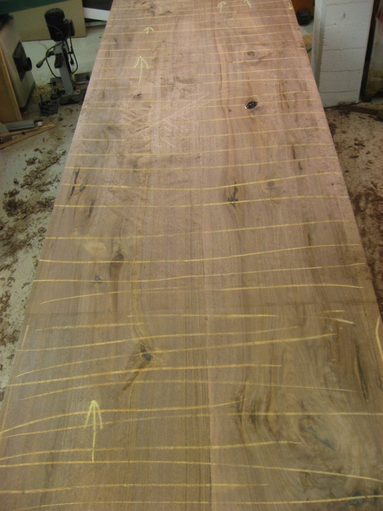 Walnut Table Top: Chalked to quickly view hand-planing progress.