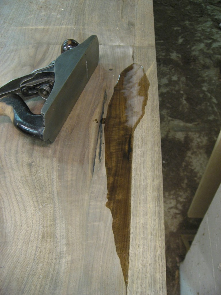 The dry epoxy fills a low spot, ready to be leveled with a hand plane