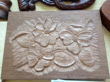 A flower carving by Mary May.