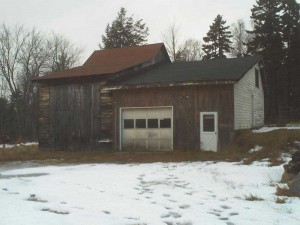 The old garage/shed on Temple's property in 2009, which he began to update and reconstruct to make his woodworking shop.