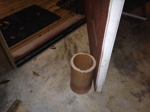 "I use this old piece of orangeburg pipe to keep the back door cracked open for ""makeup air"" when running the cyclone."