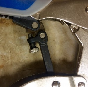 Adjustment Screw in Center of Handle