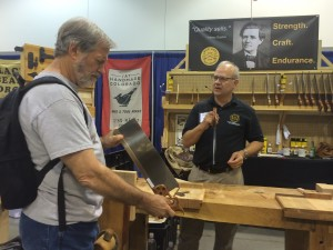 Chris Bagby taking a look at the beautiful Bad Axe saws made by Mark Harrell