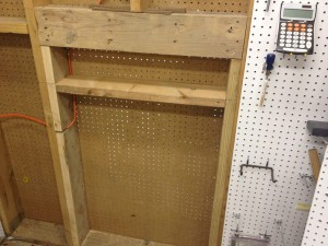 I didn't see any reason to put the pegboard back on until the opening has been used several times, just in case I need to modify it. It's big enough to accept a 2x12 or 4x4, just in case I ever work with bigger long boards. I also allowed a little extra room because sometimes wide and/or long boards can be unstable, and may bend off to one side, or have twist in them.