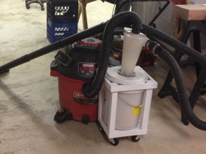 """They"" don't make 'em like this any more. Modern shop vacuum hoses are stiff, and would tend to topple the Dust Deputy over. This soft hose tucks the Dust Deputy in. The homemade cart is bottom-weighted to add stability."