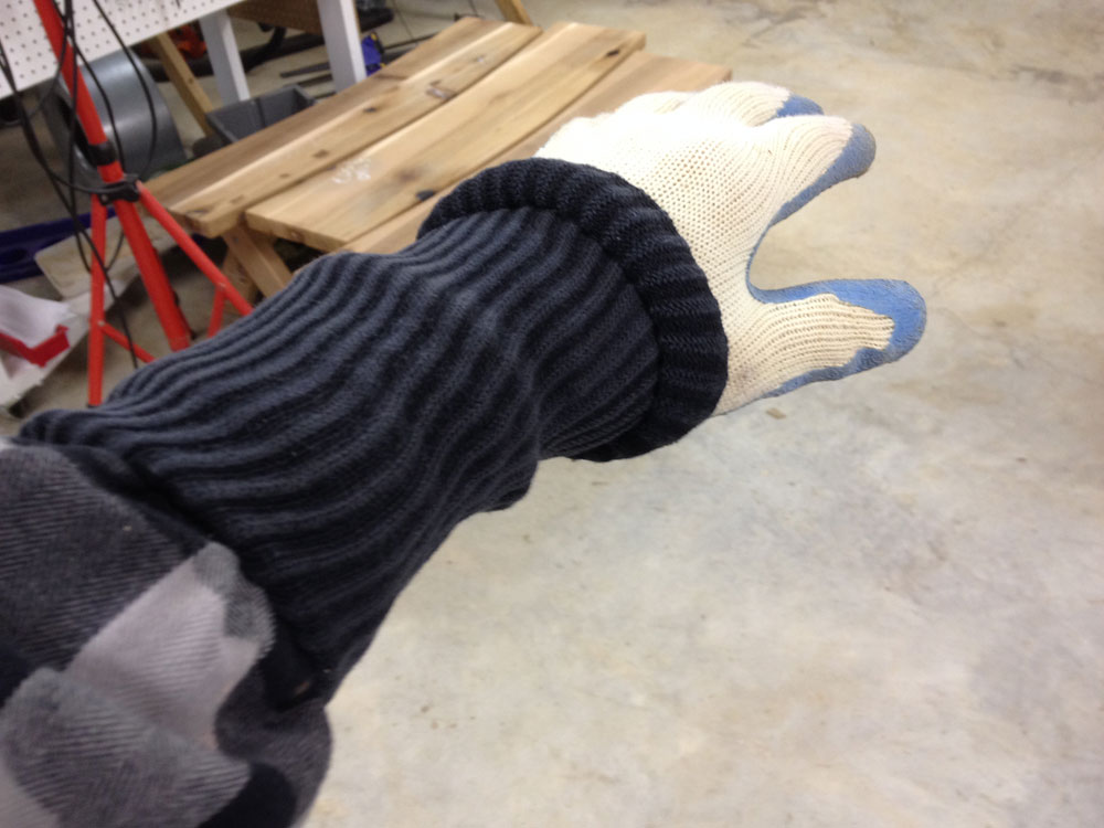 First the shirt, then the roll up the elastic part of the sock, put on the glove. Now, span the connection between the shirt and glove with the sock by rolling it out. Add tape if it makes you feel more secure.