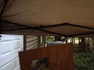 Hanging the plywood under the tent allows me to get to all surfaces for a quick paint job, rain or shine.
